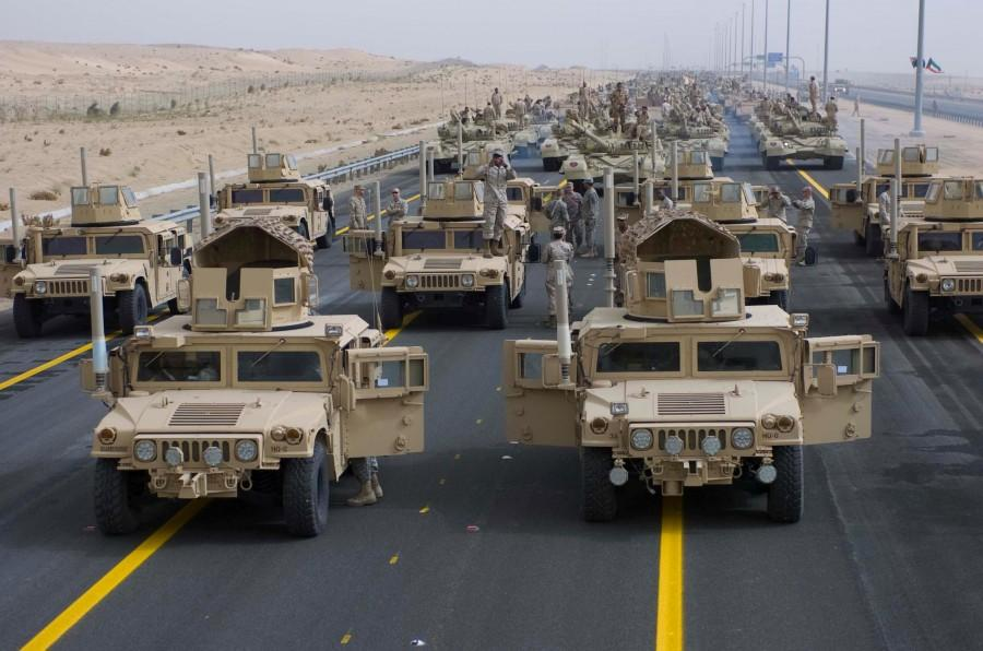 A formation of armored vehicles, manned by U.S. Army and Marine Corps personnel, stand ready to lead a convoy of coalition forces through the parade grounds established for the 50/20 celebration in Kuwait, Feb. 21. This celebration honors the veterans of Operation Desert Storm and recognizes the long standing and successful partnership that is indicative of our many friendships in the region.