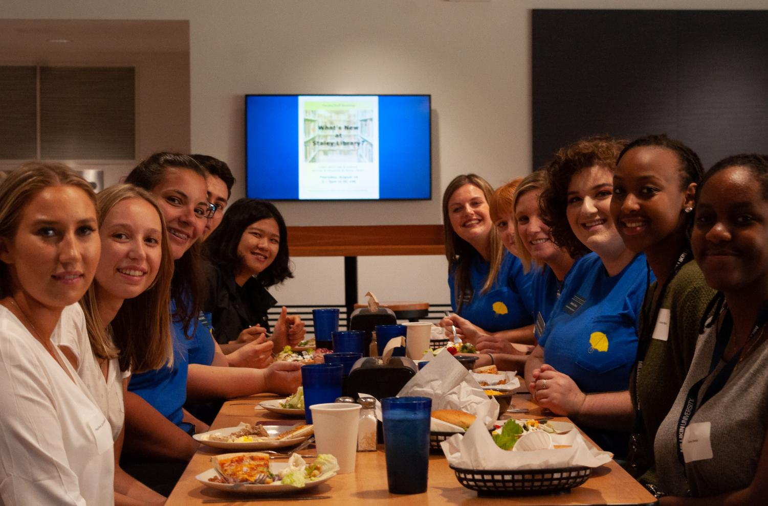 New International Students enjoy dinner with FYEMs for the first time at Millikin in the cafeteria.