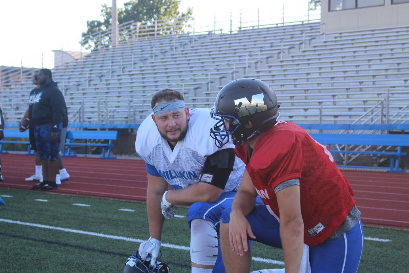 Cal and his tight end Blake Patchett going over strategy.
