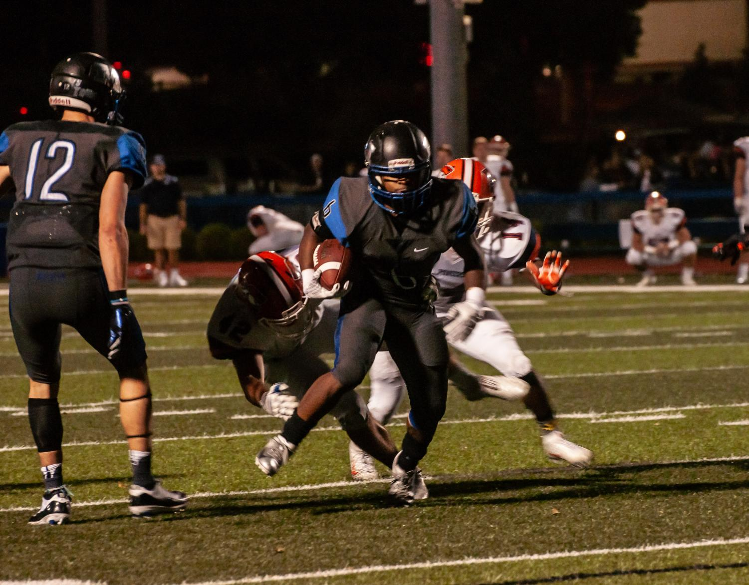 Jazontae Howard (Center) dodging Carroll Pioneers. Jordan Smith (Left) would score a touchdown on the next play.