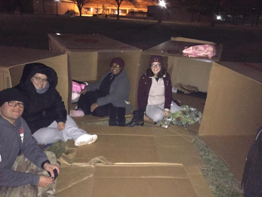 A+group+of+4+students+sitting+inside+their+boxes.