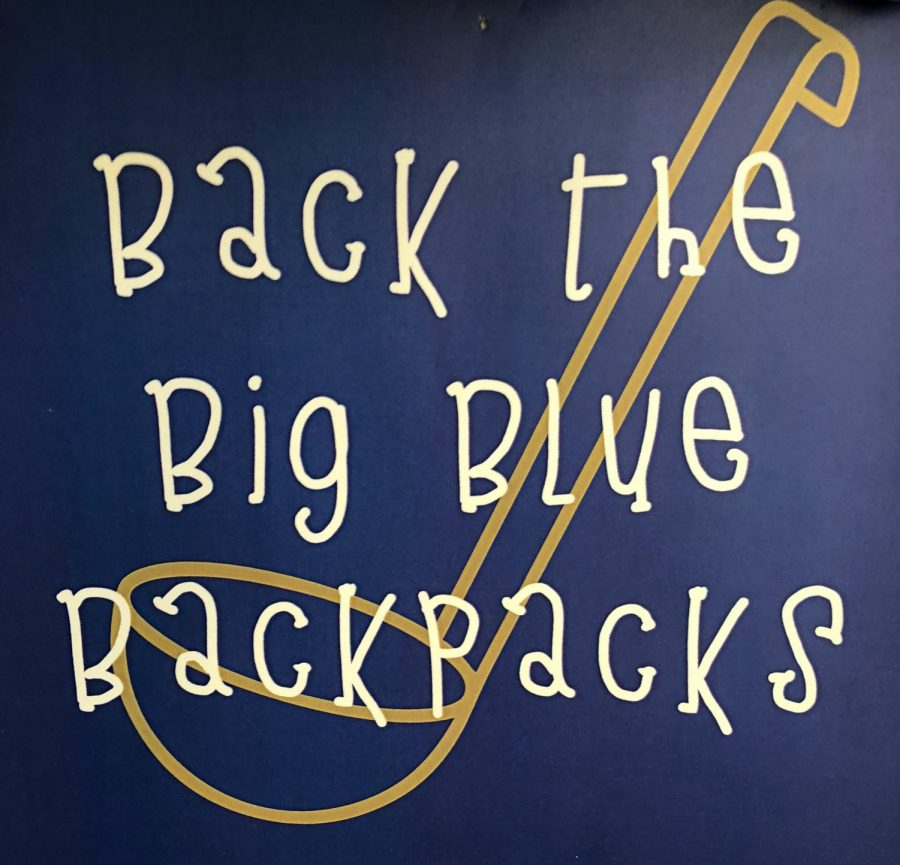 Back the Big Blue Backpacks poster. Photo by Sydney Sinks